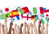 Hands holding countries Flags — Stock Photo