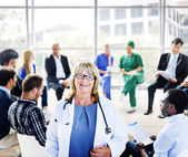 Female Doctor in Front of Support Group — Stock Photo