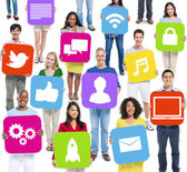 People Holding Symbols for Social Networking — Stock Photo