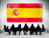 Business People and Flag of Spain — Stock Photo