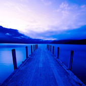 Tranquil lake with jetty — Stock Photo