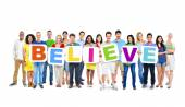 People holding placards forming believe — Stock Photo