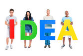 People holding 'IDEA' letters — Stock Photo
