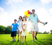 Family walking towards camera — Stock Photo