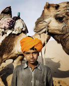 Indian camel guide — Stock Photo