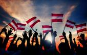 People Holding Flags of Austria — Stock Photo