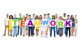 People holding placards forming teamwork — Foto Stock