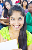 Young woman in lecture room — Stock Photo