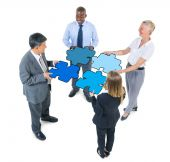 Business People Connecting Jigsaw Puzzles — Stock Photo
