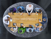 Group of People in a Table Using Devices — Stock Photo