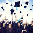 Graduation Caps Thrown in the Air — Stock Photo #52470119