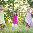 Girls running in the park — Stock Photo #52470527