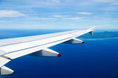 Airplane heading to an island — Stock Photo