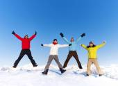 Happy people jumping in snow — Stock Photo