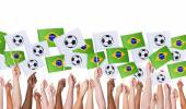 Arms Holding Brazil Flags — Stock Photo