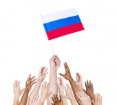 Human hand holding Russia Flag — Stock Photo