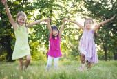 Girls running in the park — Stock Photo