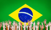 Multi-Ethnic Hands With Flag Of Brazil — Stock Photo
