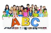 Diverse Cheerful Children Holding Letters — Stock Photo