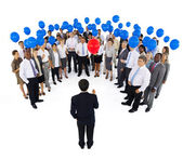 Mullti-ethnic business group with balloons — Stock Photo