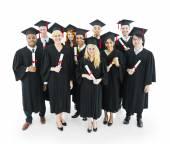 Graduates students holding their diplomas — Foto Stock