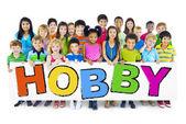 Children Holding Word Hobby — Stock Photo