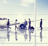 Business People Walking in Airport — Stock Photo