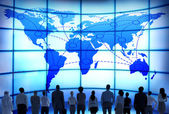 Business People with World Map — Stok fotoğraf