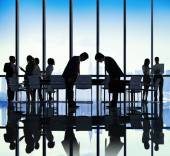 Business People Bowing Down in Office — Stock Photo