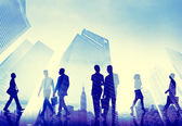 Business People walking in Cityscape — Stock Photo