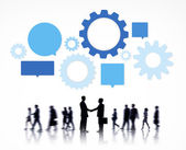 Business People with gears symbols — Stock Photo