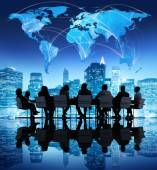 Business people and world map — Stock Photo