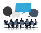 Business People Discussing with Speech Bubbles — Stock fotografie
