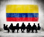 Business People with Colombian Flag — Stock Photo