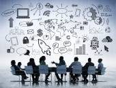 Business People Meeting with Business Symbols — Stock Photo