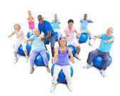 Adults Exercising Yoga With The Instructor — Stock Photo