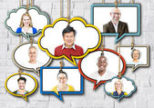 Set of Faces on Hanging Colorful Speech Bubbles — Stock Photo