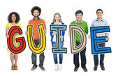People Holding Guide Letter — Stock Photo