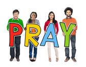 People Holding Letter Pray — Stockfoto