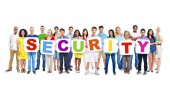 Multi-Ethnic Group Of People Holding Alphabet To Form Security — Stock Photo