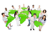 People holding world map — Stock Photo