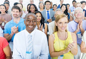 Mature business people attending seminar — Stock Photo