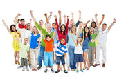 People celebrating with hands raised — Stock Photo