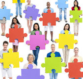 People holding Jigsaw puzzles — Stock Photo
