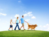 Family Walking with Their Pet Dog — Stock Photo