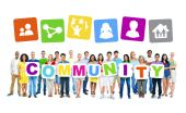 People holding placards forming community — Stock Photo