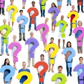 Group of people holding Question mark — Stock Photo