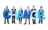 Business People Holding word Change — Stock Photo