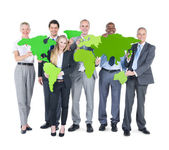 Business People holding world map — Stok fotoğraf