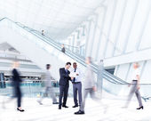 Business people in Shopping Mall — Stock Photo